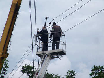 Electricians on the tower repair high-voltage wires №608