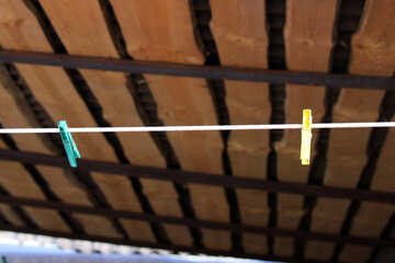 Two pegs on the washing line under canopy №684