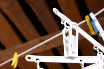 White clothespin with drying laundry close №695