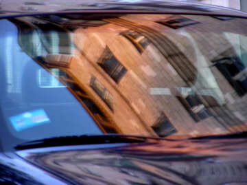 Reflection of buildings in the glass of the car. №327