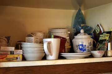 Soot on the kitchen shelf with dishes №976