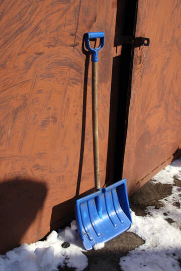 Plastic shovel for cleaning on the background of the gate №692