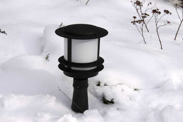 Low garden park lamp in the snow №506