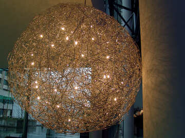 A street lamp in the form of ball of metal wire with lights. №380