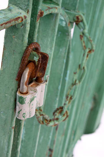 Padlock with chain on gate in the snow №519