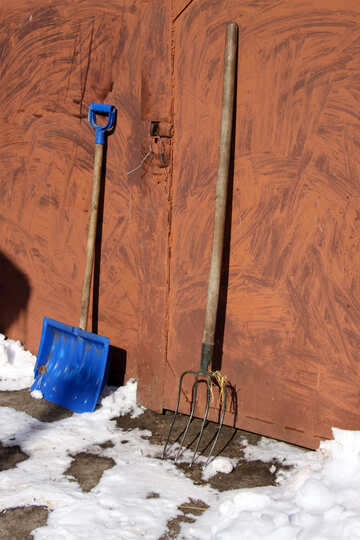 Farming tools. Pitchfork and spade on the background of the gate. №686