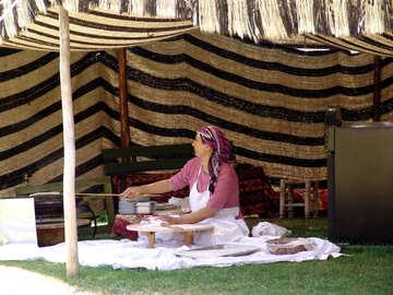 The Turkish woman bakes Turkish flat cakes (gozleme, gezlenme, pide) under canopy №182