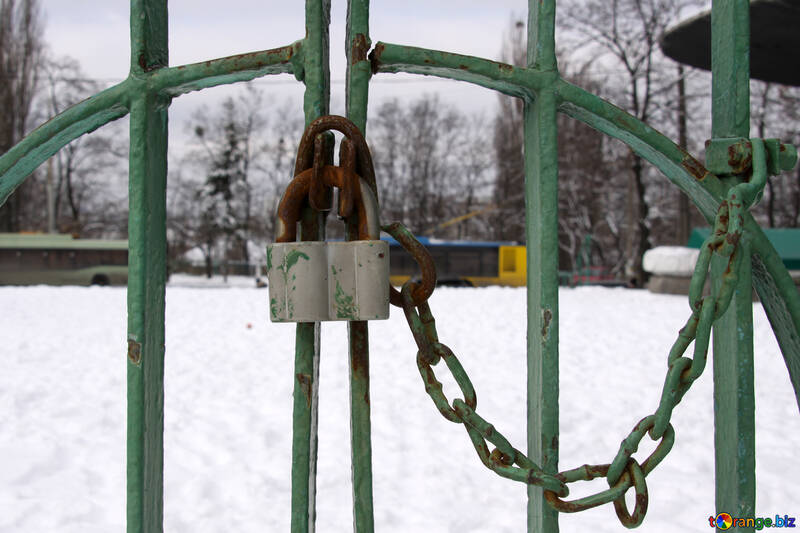 Castle mounted with chain on the gate of the park trolley №517