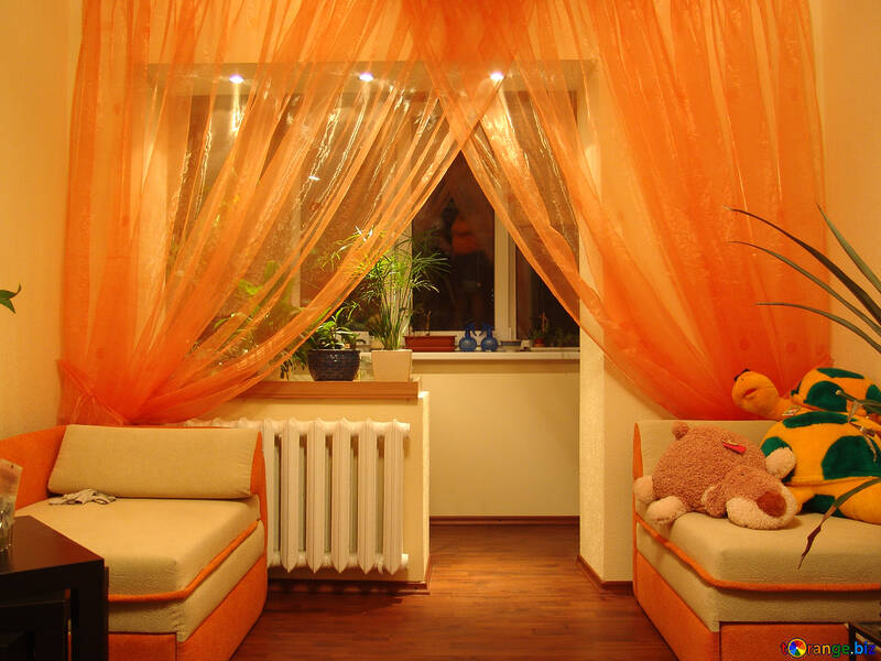 Orange curtains on the window with backlight №613