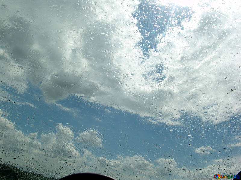 Low clouds through wet windscreen №635