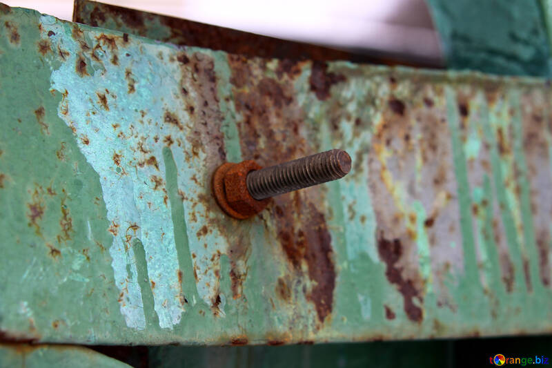 Rusty bolt with nut and washer on rusted painted metal №520