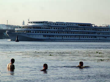 The swimming people in the background cruise ship №1986