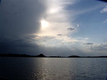 The sun in the storm cloud over the lake №1992