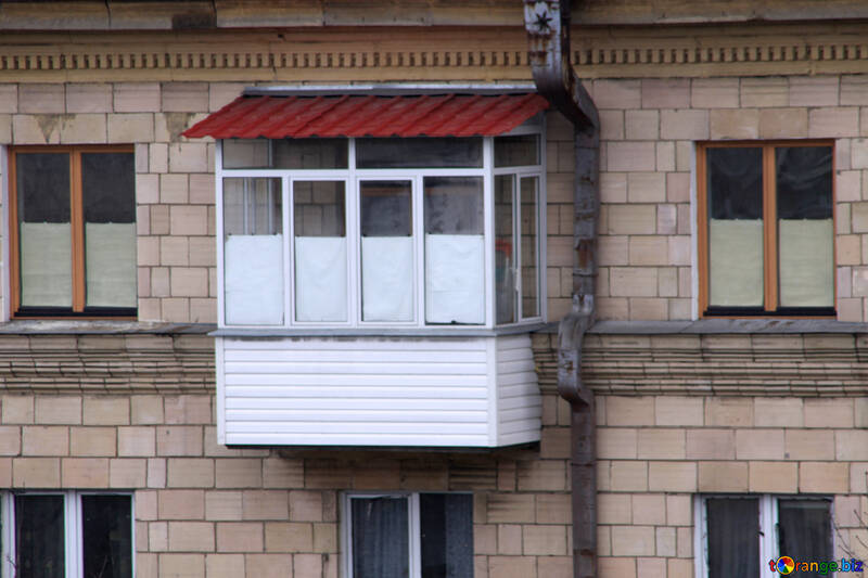 Balcony under the roof of glass and trimmed with metal and plastic siding №1356