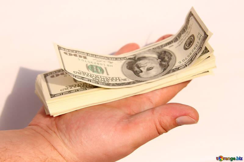 Стопка долларов на ладони №1545