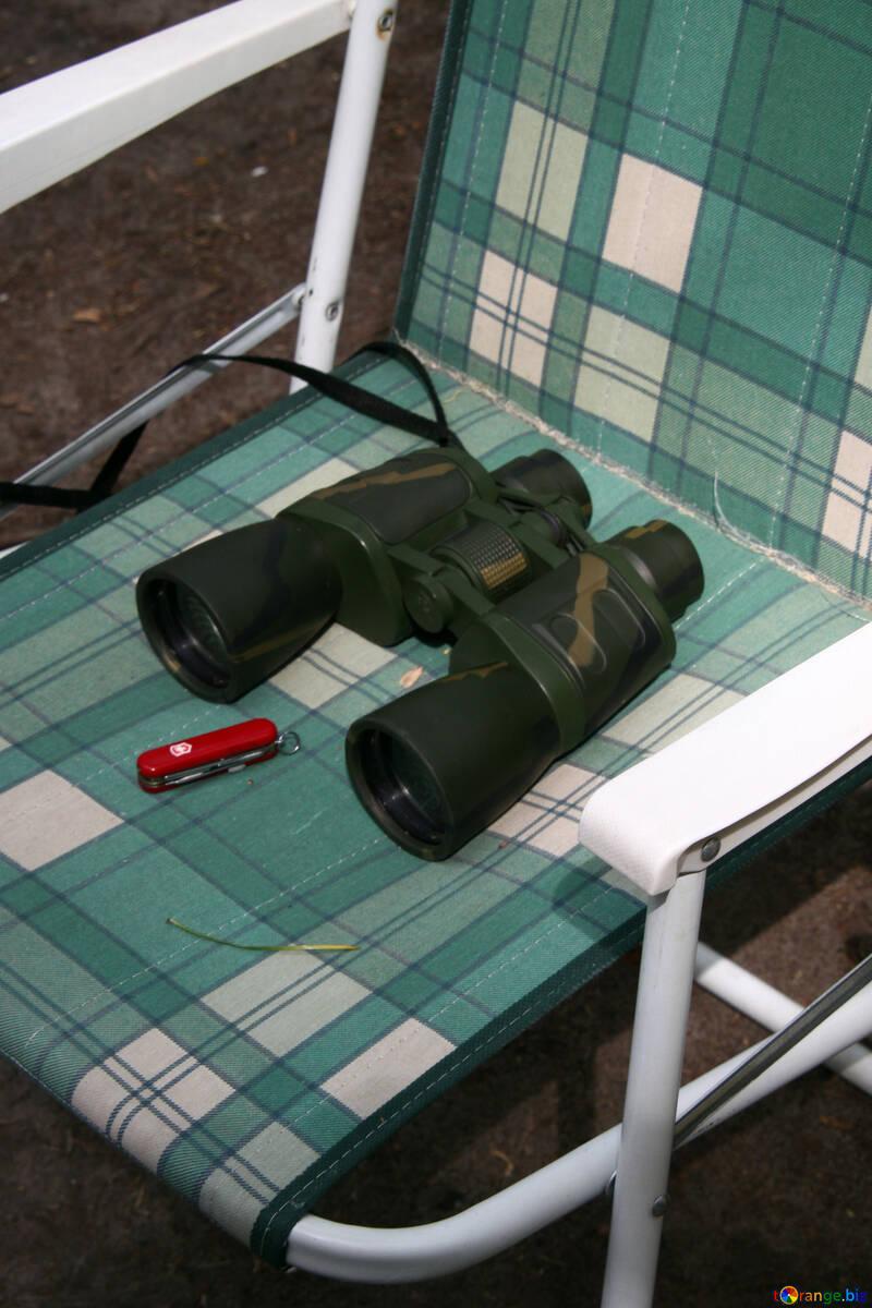 Binoculars and knife on folding chair №1676