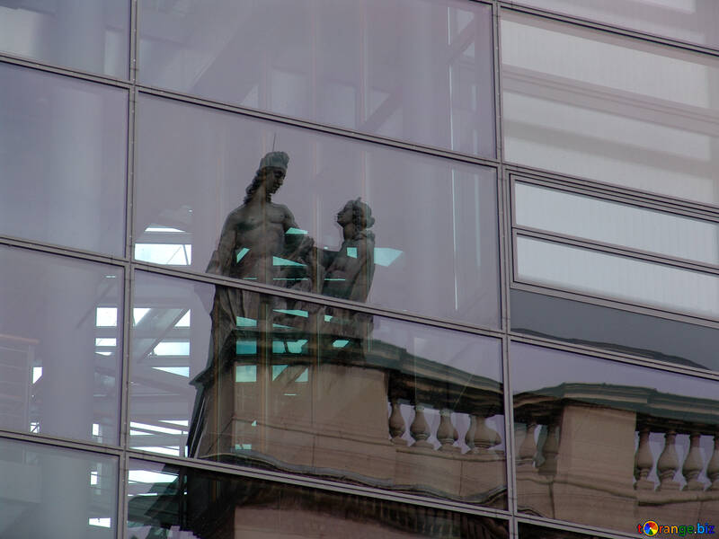 Reflection of old sculptures in the skyscraper №11923