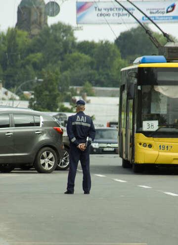 Ukrainian policeman with baton from behind №14714