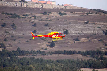 Helicopter flying in the mountains №2625