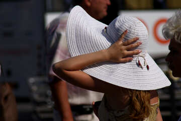 The girl holds the hand wide-brimmed hat №2213