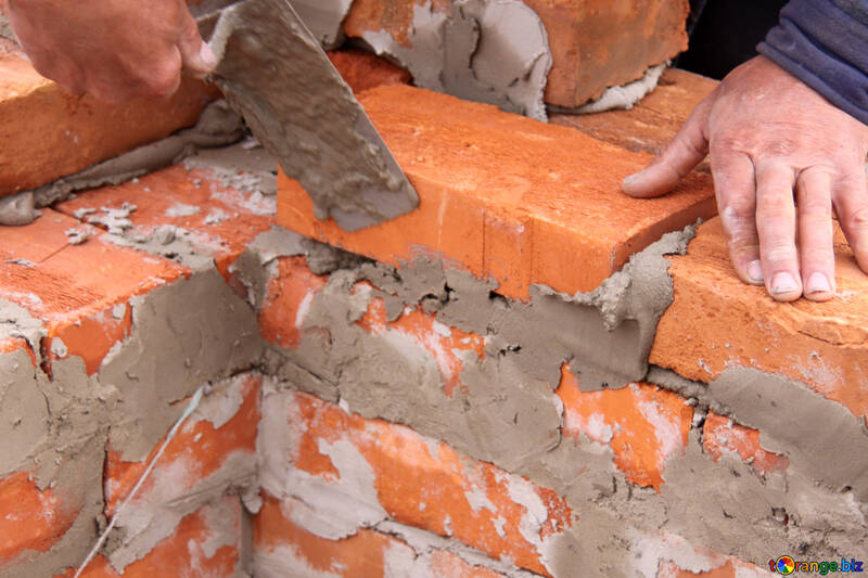 Laying brick in the wall  №2888
