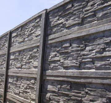 Ein Zaun aus Beton №20049