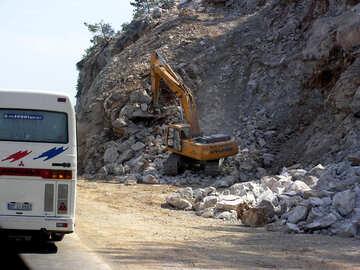 Bagger sammelt Steine №21159