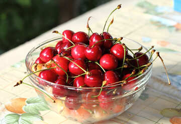 Sweet cherries in bowl on the table №22186