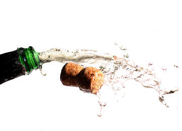 Champagne cork flying out of the bottle with spray №25079