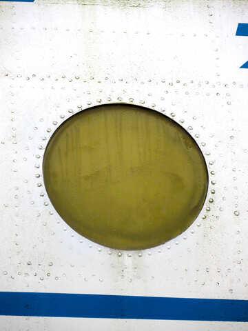 Textur der das runde Fenster im Flugzeug mit Nieten №26431