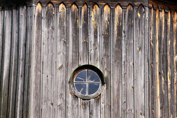 Antique round window in the wooden wall  №3126