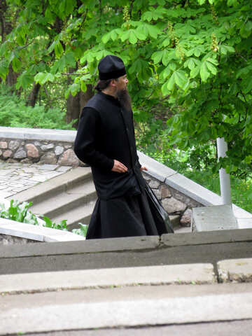The priest in black cassock №31179