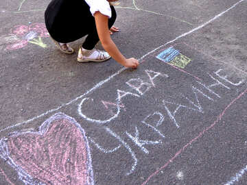 Glory To Ukraine! child`s drawing chalk on asphalt №32583