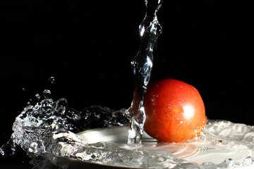 Tomatoes under running water