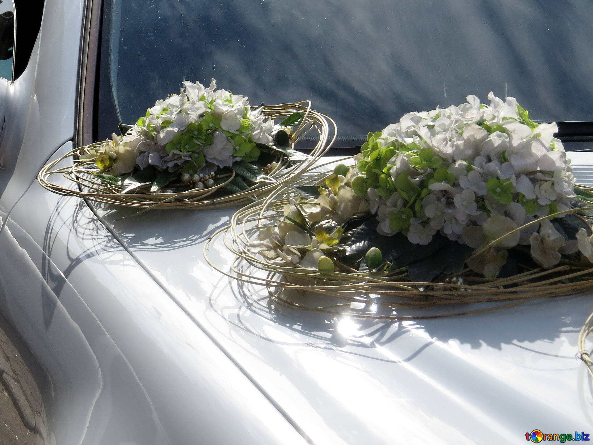 Wedding Decorations For Cars Bouquets Of Flowers On The Hood Of Car