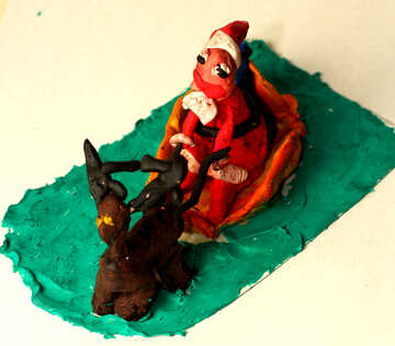 Children`s crafts out of clay Santa Claus in sleigh №35632