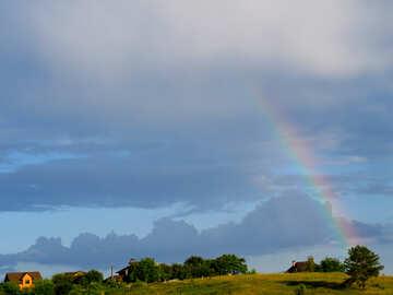 Regenbogen über dem Dorf №36748