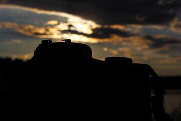 Silhouette macchina fotografica al tramonto  №36367