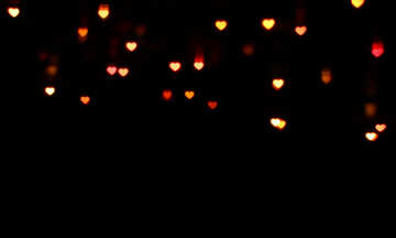Lights hearts on dark background №37845
