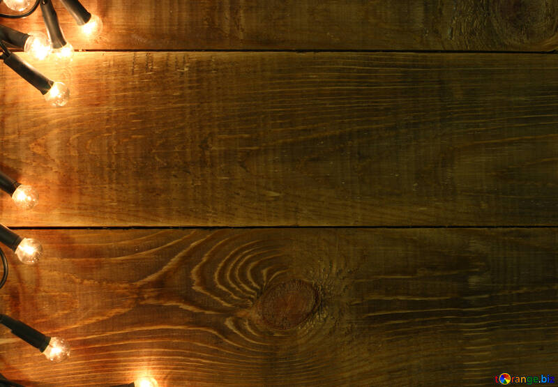 New Year Garland On A Wooden Wall Christmas Background Shine