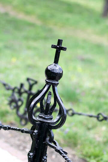 Metal cross on the fence №39885