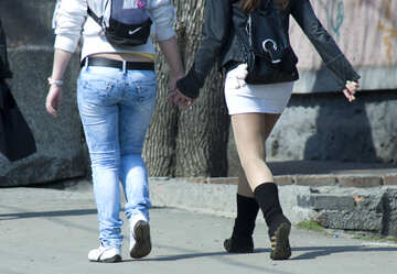 Two  Girls  hold   hand  type  behind. №4592