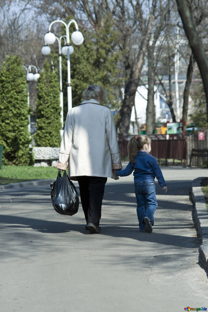 Grandmother and granddaughter walk in the park. №4533