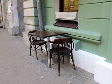 Table and chair near a sidewalk cafe №41266
