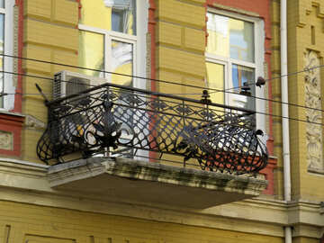 Balcony with wrought iron railing №41267