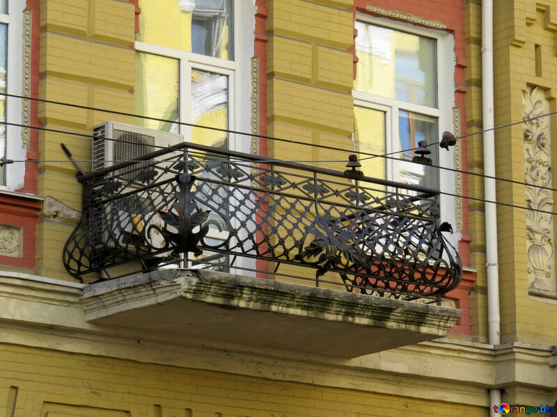 Balcony with wrought iron railing №41267