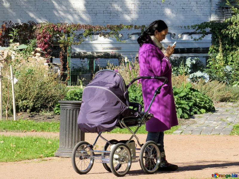 Woman with stroller near an urn №41192