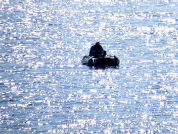 Fisherman on the inflatable boat №42504
