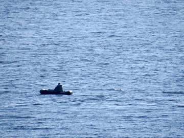A fisherman in a rubber boat №42499