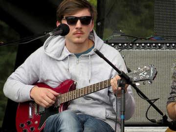 A man plays a guitar №42462